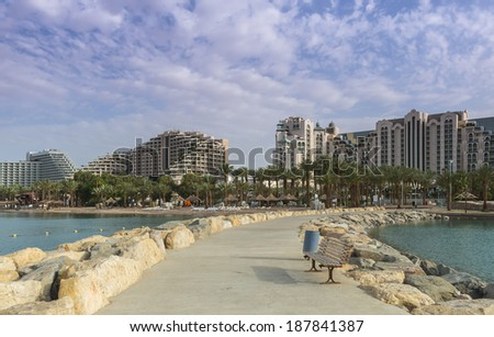 View on the central beach of Eilat from the main stony pier, Israel - stock photo
