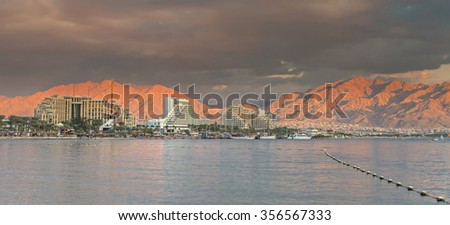 View on the central beach of Eilat. In Israel, Eialt is the southernmost tourist city, located on northern shores of the Red Sea. The city is one of the main resort and recreation center in Israel  - stock photo