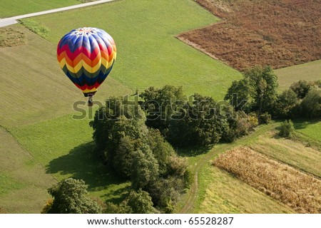 View on the colorful hot air balloon from above. - stock photo
