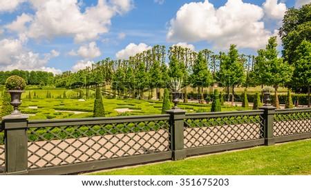View on the gorgeous park under a blue sky with magical clouds near Frederiksborg castlea, Hillerod, Denmark - stock photo