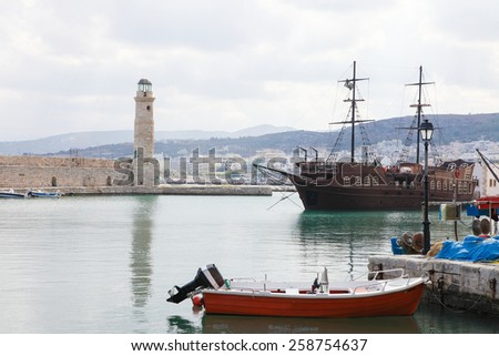 View on the harbor and famous lighthouse in the city of Rethymno on the island of Crete, Greece. - stock photo
