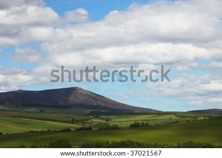 view on the highlands from the distillery of glenlivet - stock photo