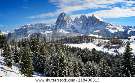 View on the Langkofel and Plattkofel (Sassolungo and Sassopiatto) dolomites mountains over the Alpe di Siusi or Seiser Alm in South Tyrol, Italy in winter.  - stock photo