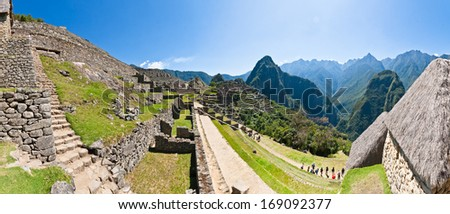 View on the Machu Picchu mountain from within the old town - stock photo