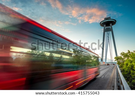 View on the Modern bridge with observation deck and restaurant called UFO in Bratislava city at the sunset. Long exposure technique with motion of cars - stock photo