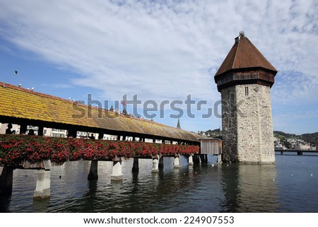 View on the old wooden chapel bridge in Lucerne Switzerland . - stock photo