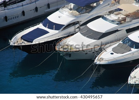View on the prow of white yachts in harbor - stock photo