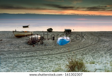 View on the sandy beach and facilities of fishing company, Gulf of Riga, Baltic Sea, Latvia - stock photo