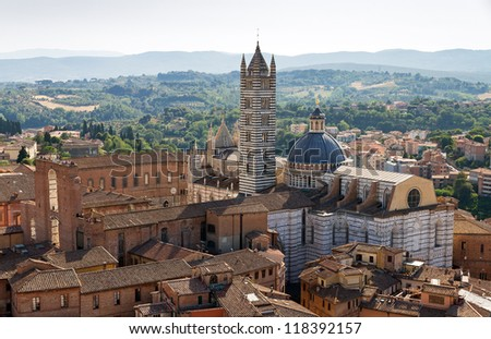 View on the Siena Cathedral from the Torre del Mangia in Siena, Italy - stock photo