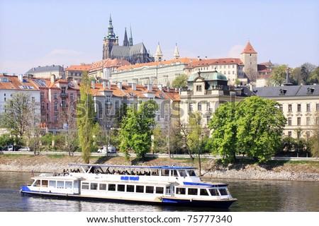 View on the spring Prague gothic Castle above River Vltava, Czech Republic - stock photo