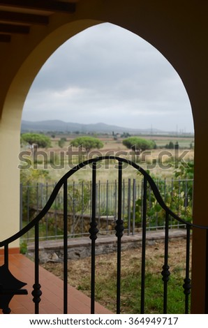 View on the terrace in Tuscany, Italy.  Weather is cloudy, it is raining. - stock photo