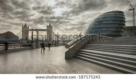 view on Tower Bridge from More London Place on an early cloudy morning - stock photo