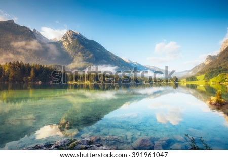 View on turquoise water and scene of trees on a rock island at Lake Hintersee. Location famous resort National park Berchtesgadener Land, Upper Bavaria, Alps. Europe. Artistic picture. Beauty world. - stock photo