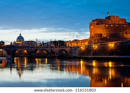 View on Vatican and Castle Sant' Angelo over the Tiber river at night. - stock photo