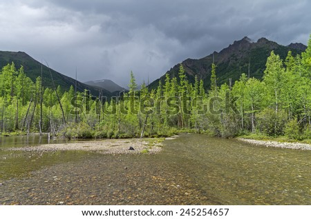 View on Zhombolok - small river in Eastern Sayan Mountains. Siberia, Russia. - stock photo