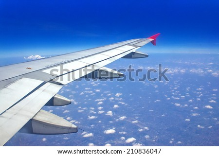 View out of airplane Airplane wing in flight  - stock photo