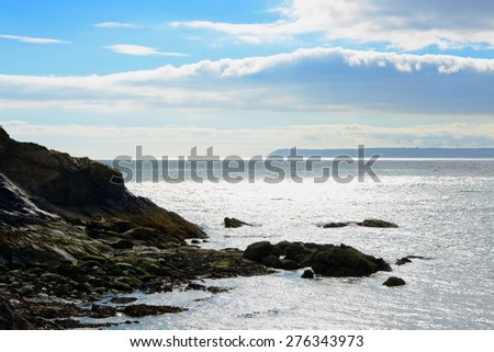 View out to sea from Polkerris in Cornwall, England. High contrast - stock photo