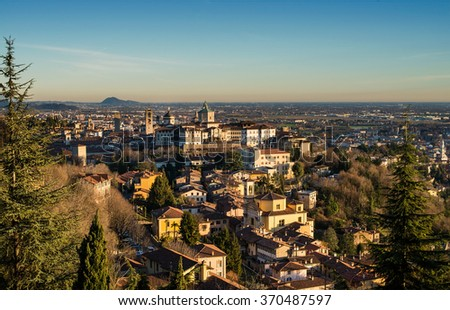 View over Citta Alta or Old Town buildings in the ancient city of Bergamo, Lombardia, Italy on a clear day, taken from San Virgilio point - stock photo