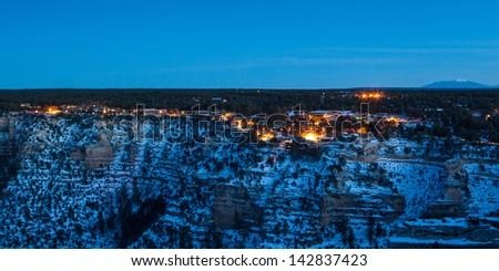 View over Grand Canyon village toward Humphreys Peak and Flagstaff at dusk. In Arizona, USA. - stock photo