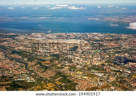 View over Lisbon, Portugal with airport, ponte vasco da gama, river tejo  - stock photo