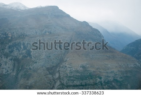 View over misty mountain rock in the Moraca river canyon in north Montenegro, Balkan peninsula, in winter - stock photo
