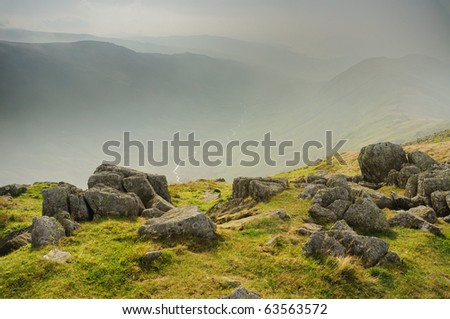 View over misty Rydal valley in the English Lake District - stock photo