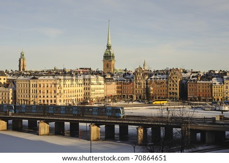 View over Old town, Stockholm and subway train - stock photo