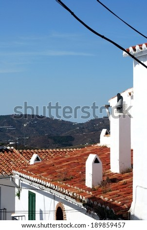 View over rooftops towards the mountains,  whitewashed village (pueblo blanco), Frigiliana, Costa del Sol, Malaga Province, Andalucia, Spain. - stock photo