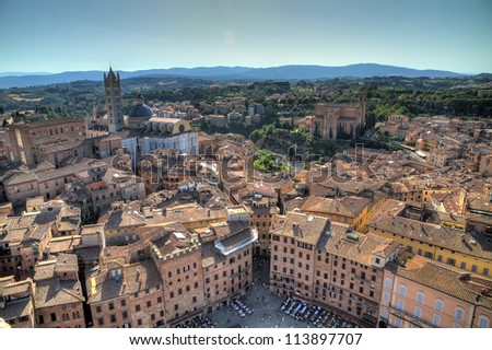 View over Siena from the Torre del Mangia on Piazza del Campo. HDR - stock photo