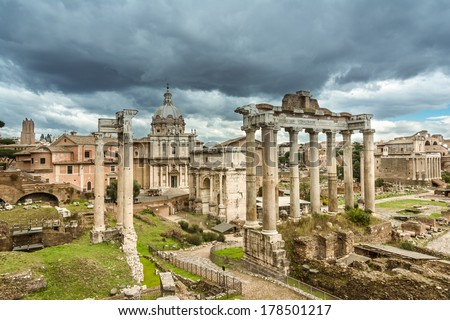 View over the ancient Forum of Rome showing temples, pillars, the senate and ancient streets - stock photo