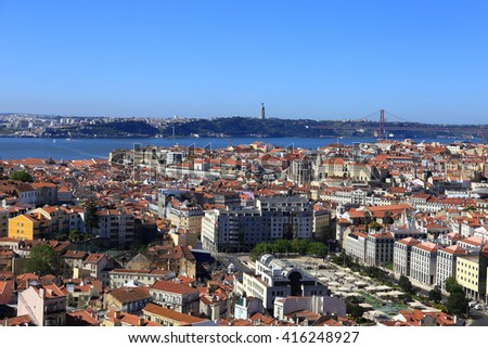 View over the city of Lisbon in Portugal from the highest point in the city the Miradouro da Senhora do Monte. - stock photo