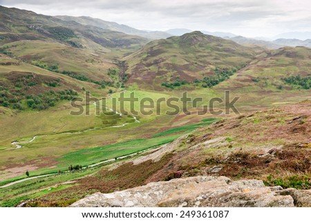 View over the hills and slopes of the Scottish Highlands around Loch Ness - stock photo