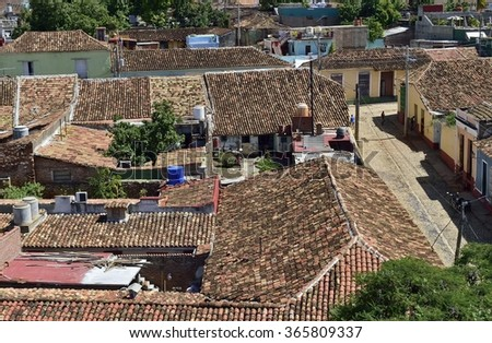 View over the roofs of  Colonial town cityscape of Trinidad, Cuba. UNESCO World Heritage Site. Colourful houses of the Trinidad, Cuba - stock photo
