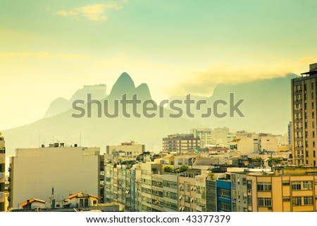 view over tops of residential buildings and mountains in Ipanema Rio de Janeiro Brazil - stock photo