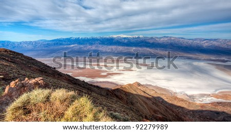 View overlooking Badwater Basin in Death Valley National Park.  Telescope Peak with snow can be seen across the valley floor.  Taken from Dante's View. - stock photo