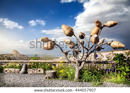 View point in Pigeon valley and tree decorated with pots in Cappadocia, Turkey - stock photo