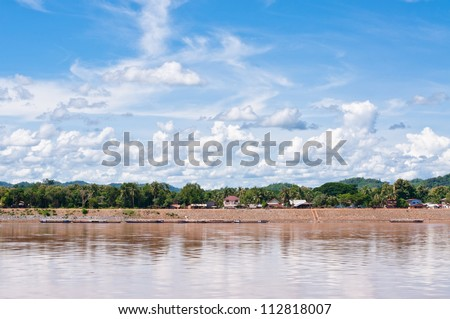 view Ships anchored on the river bank of mekong river - stock photo