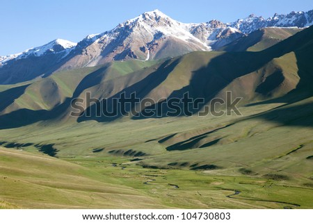 View Small river in alpine meadows, Tien-Shan mountains - stock photo