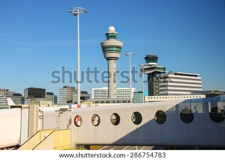 View the control tower and other buildings from the window of the airport - stock photo