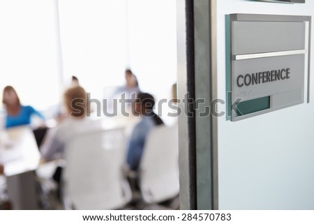View Through Door Of Conference Room To Business Meeting - stock photo