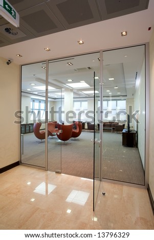view to a meating room through glass wall - stock photo