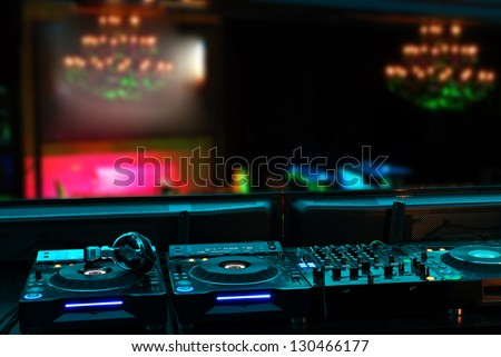 view to a night club over dj decks - stock photo