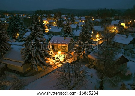 View to a night village covered with snow - stock photo