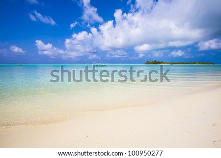 view to a tropical island from the beach - stock photo