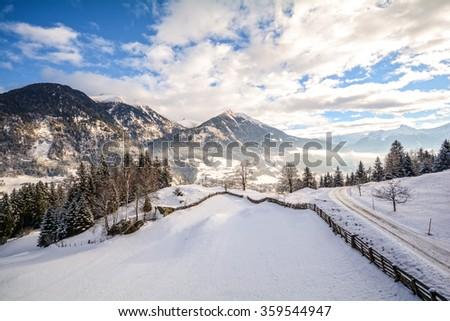 View to a winter landscape with mountain range and Gasteinertal valley near Bad Gastein, Pongau Alps - Salzburg Austria Europe - stock photo