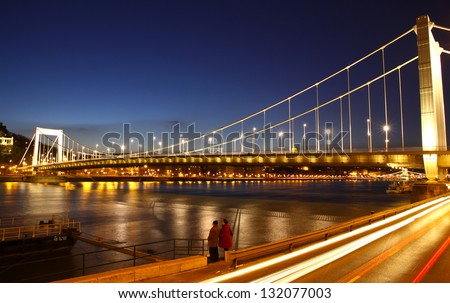 View to Elisabeth Bridge (Erzsebet hid) and Danube river at evening. Budapest, Hungary - stock photo