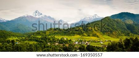 View to Machhapuchchhare and the Annapurna Range from near Purunchaur, outside Pokhara, Nepal - stock photo