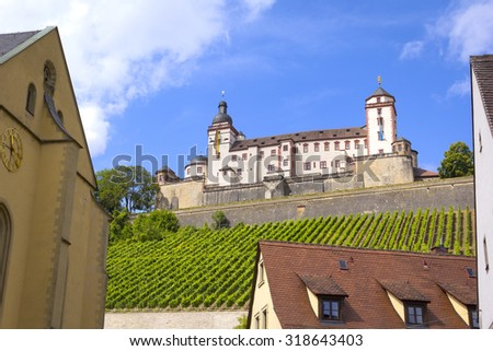 View to Marienberg Fortress, Wuerzburg, Germany. The fortress is situated above vineyards, on the left bank of the Main River in Wuerzburg, in the Franconia region of Bavaria, Germany.  - stock photo