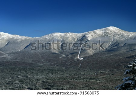 View to Mount Washington in New Hampshire from summit of Bretton woods ski area at early winter - stock photo
