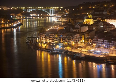 View to Porto over river Douro with reflection of the lights at night - stock photo